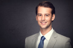 Young businessman smiling Royalty Free Stock Image