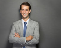 Young businessman smiling with folded arms Royalty Free Stock Image
