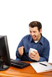 Young Businessman Smiling in front of Computer Royalty Free Stock Images