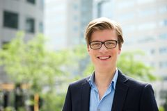 Young businessman smiling with glasses Royalty Free Stock Photos