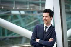 Young businessman smiling outdoors Royalty Free Stock Photography