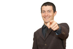 Young businessman smiling and pointing royalty free stock photos