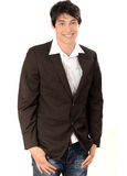 Young businessman smiling standing with the hands in the pocket. Royalty Free Stock Image