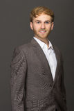 Young businessman smiling wearing casual suit Stock Photography