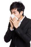 Young businessman sneeze Royalty Free Stock Photos