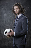 Young businessman with a soccer ball Royalty Free Stock Photos
