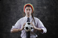 Young businessman with a soccer ball Stock Image