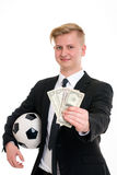 Young businessman with soccer ball and money Royalty Free Stock Photography