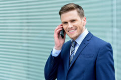 Young businessman speaking on his cell phone Royalty Free Stock Photo
