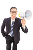 Young businessman speaking on a megaphone. Isolated on white background Stock Photo