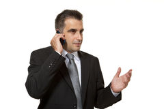 Young businessman speaks in mobile phone. Young businessman that wears suit and tie speaks in mobile phone stock photos