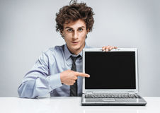 Young businessman specify at screen laptop Stock Photography