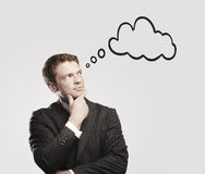 Young businessman with speech bubbles inside. Royalty Free Stock Photography