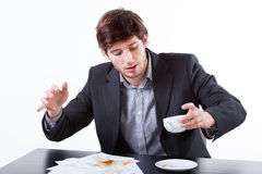 Young businessman spills coffee for documents Stock Images