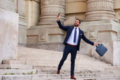 Young businessman on the stairs Stock Photo
