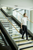 Young businessman on the stairs Royalty Free Stock Image
