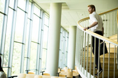 Young businessman on the stairs Royalty Free Stock Photos