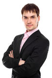 Young businessman stand with crossed hands. Isolated Royalty Free Stock Photos
