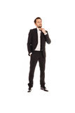 Young businessman standing adjusting his tie Royalty Free Stock Photography