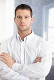 Young businessman standing arms crossed Royalty Free Stock Photo
