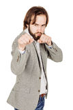 Young businessman standing in boxer position and ready to fight Stock Images