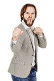Young businessman standing in boxer position and ready to fight Royalty Free Stock Image