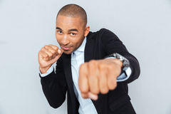 Young businessman standing in boxer position Stock Photos