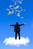 Young businessman standing on the cloud Stock Images