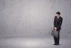 Young businessman standing confused Stock Image