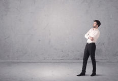 Young businessman standing confused Royalty Free Stock Photos
