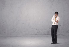 Young businessman standing confused Stock Photo