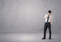 Young businessman standing confused Royalty Free Stock Image