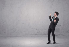 Young businessman standing confused Royalty Free Stock Photography