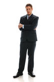 Young Businessman standing with crossed arms Royalty Free Stock Photos