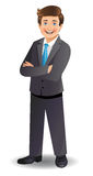 Young businessman standing with folded arms Stock Photo
