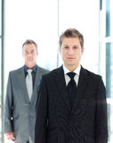 Young businessman standing in front of the camera Stock Image