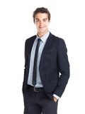 Young businessman standing with hands in pockets Royalty Free Stock Photos