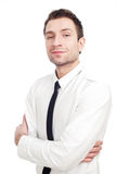 Young Businessman standing with his arms crossed. Isolated on white. He's smiling lightly Royalty Free Stock Photos