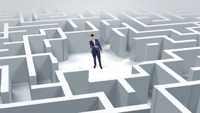 Businessman standing in a middle of a maze royalty free stock images