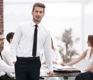 Young businessman standing in modern office. Business people stock photo