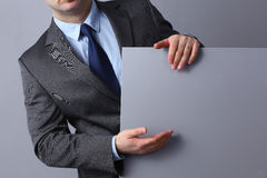 Young businessman standing near a blank board Stock Image