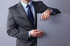 Young businessman standing near a blank board Royalty Free Stock Photo