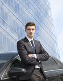 Young businessman standing near his car Stock Images