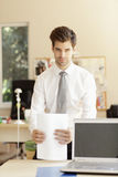 Young businessman standing in office Stock Image