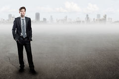 Young  businessman standing over city background Royalty Free Stock Photo