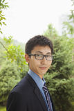 Young businessman standing in the park, portrait Royalty Free Stock Photos