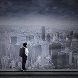Young businessman standing on the top of skyscraper Royalty Free Stock Photography