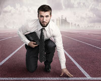 Young businessman in the starting position Royalty Free Stock Photos