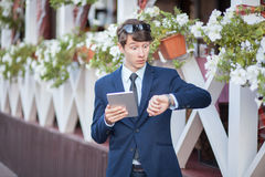 Young businessman in the street with tablet Stock Photos
