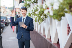 Young businessman in the street with tablet Royalty Free Stock Images
